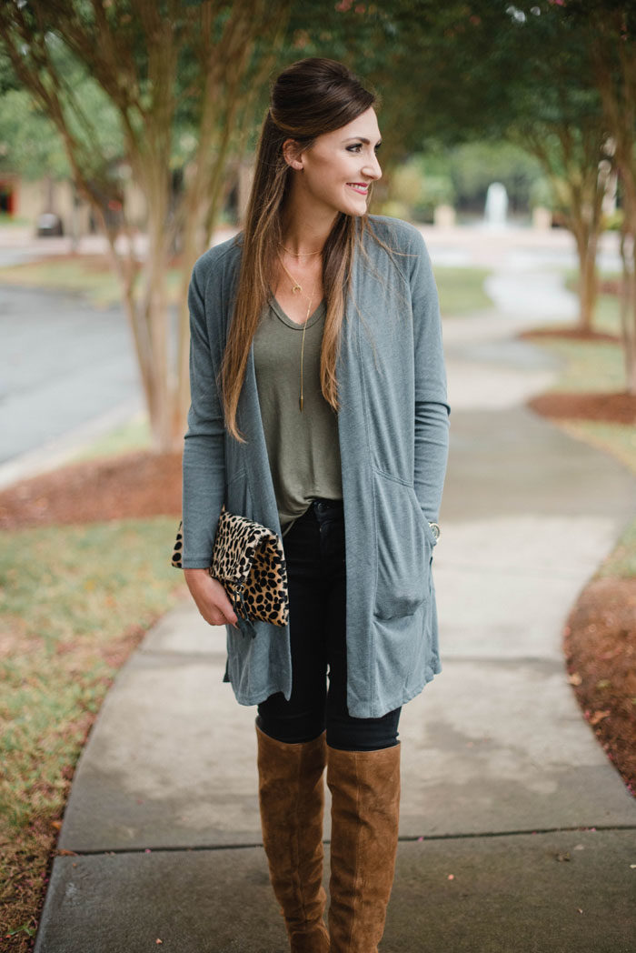 Blogger Mallory Fitzsimmons of Style Your Senses shows how to wear simple layers like a long cardigan and over the knee boots for a casual Fall look.