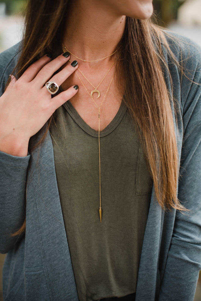 Dainty layered gold BaubleBar necklaces.
