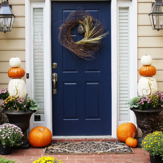 Fall Porch with pumpkin topiary featured by popular Dallas life and style blogger, Style Your Senses