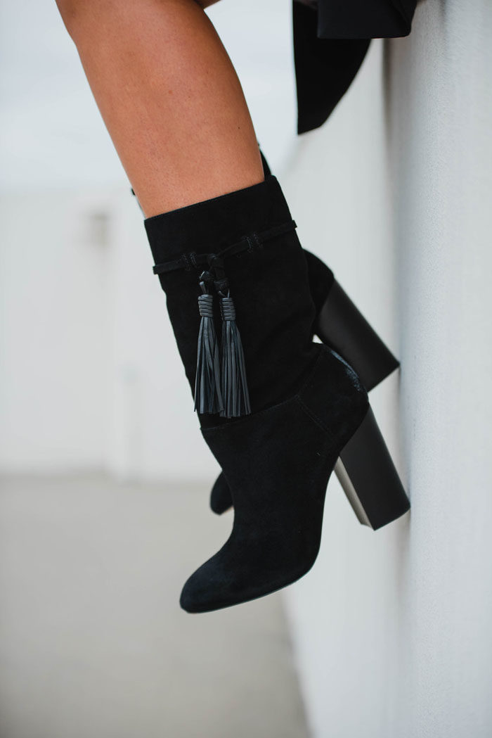 Black Suede Vince Camuto mid calf booties with tassels