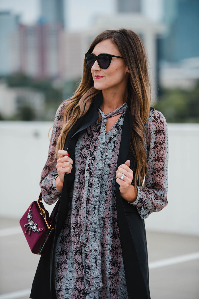 Blogger Mallory Fitzsimmons of Style Your Senses wears a Cece by Cynthia Steffe paisley dress with a black trench vest and Vince Camuto mid calf booties