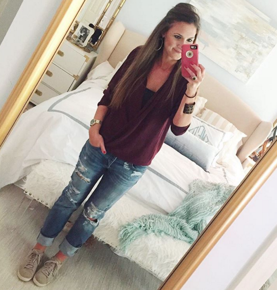 I paired this wrap front sweater with distressed denim and sneakers for a casual and comfortable #momiform