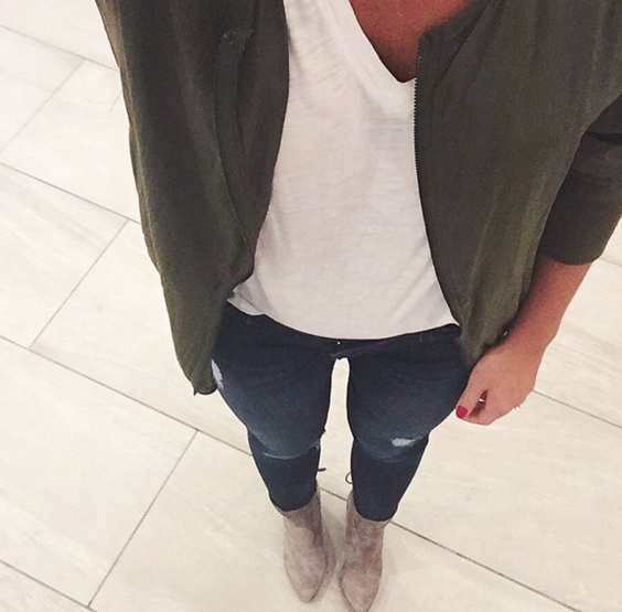army green bomber jacket with distressed skinny jeans