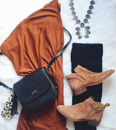 Fashion flat lay with rust cardigan, zella leggings and booties