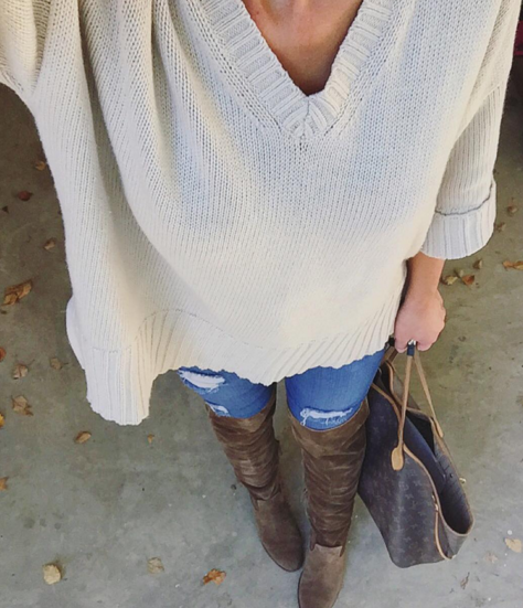 Oversized sweater paired with skinny jeans and over the knee boots