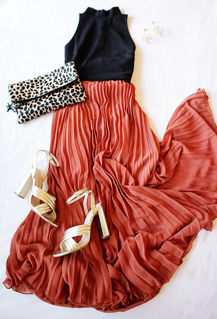 Long pleated maxi skirt with gold heels and a leopard clutch