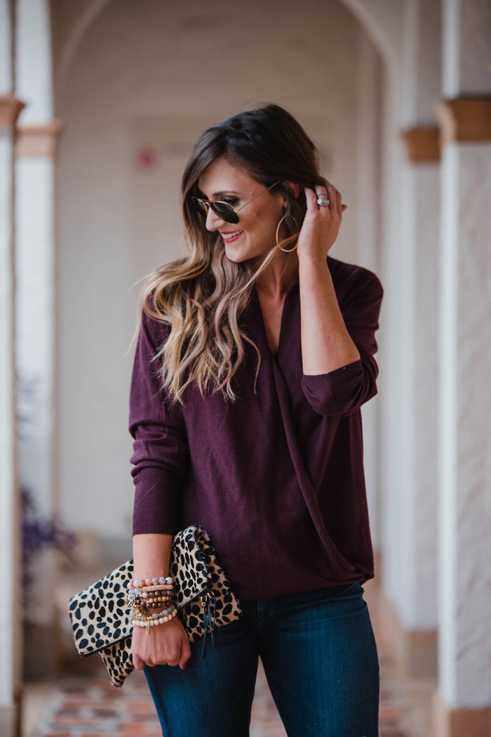 Blogger Mallory Fitzsimmons of Style Your Senses is wearing a merlot wrap front sweater and distressed skinny jeans for a Fall casual outfit that's chic and comfortable