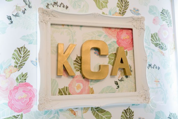 Gorgeous gold monogram over floral watercolor wallpaper from Anthropologie