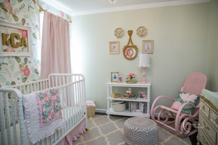 Beautiful baby girl nursery with pink drapes, classic Jenny Lind crib and trellis rug