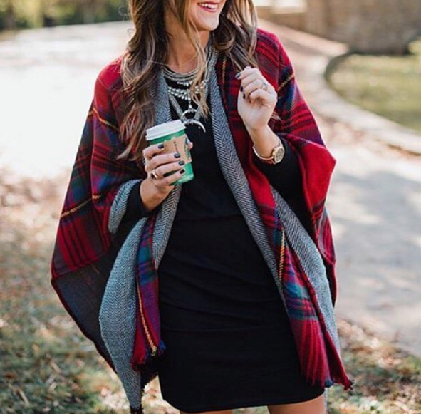 Blogger Mallory Fitzsimmons of Style Your Senses wears a plaid reversible cape and statement necklace for a cozy and festive Holiday look.