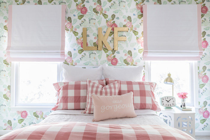 Big girl room reveal with floral wallpaper, gingham bedding and bold gold monogram over the bed