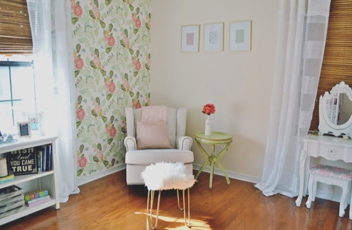 Beautiful baby girl nursery with floral wallpaper from Anthropologie and a classic Jenny Lind crib.