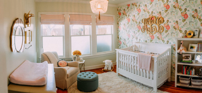 Beautiful Baby Girl nursery with floral wallpaper from Anthropologie, beaded chandelier and light pink roman shades.