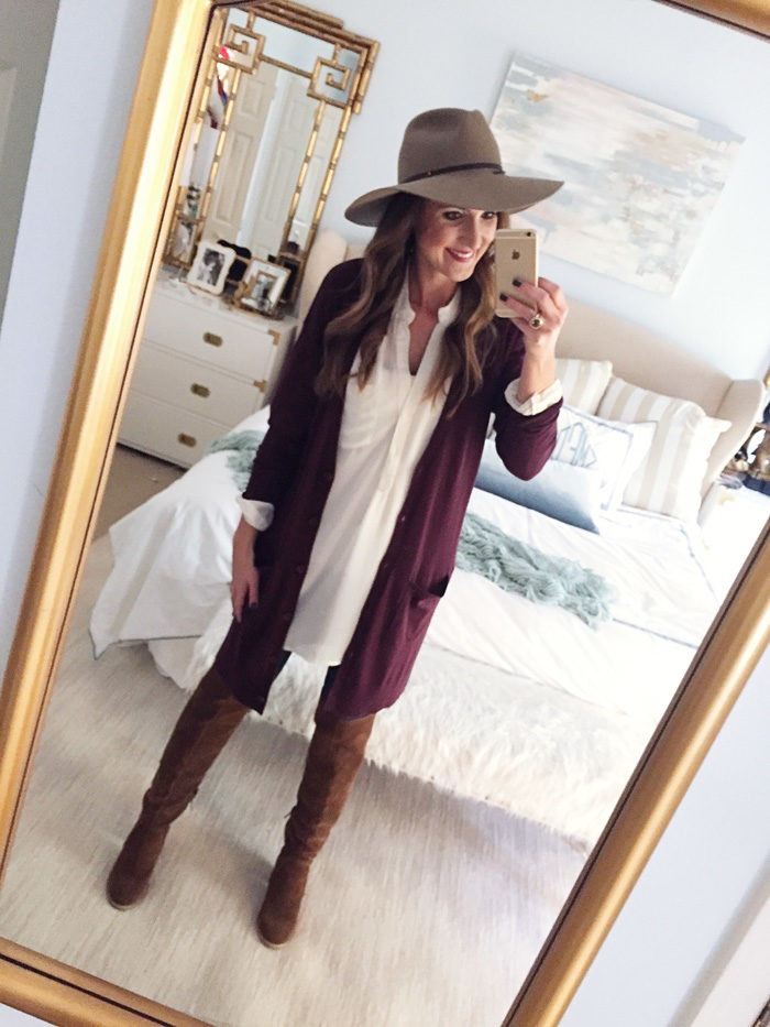 Blogger Mallory Fitzsimmons of Style Your Senses wears a plum tunic cardigan with skinny jeans and over the knee boots for a festive Thanksgiving outfit idea
