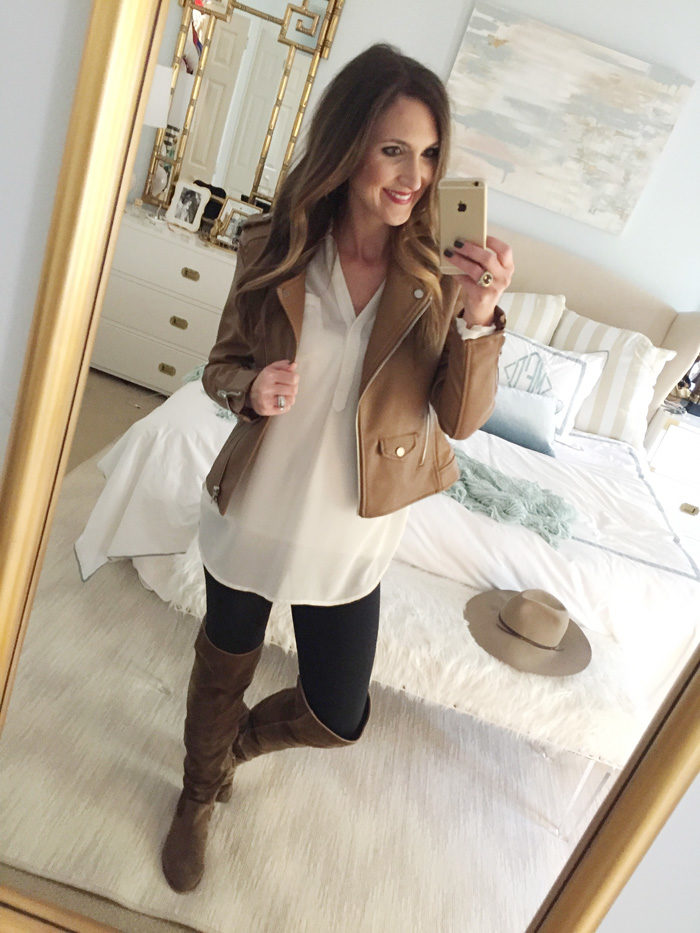 Blogger Mallory Fitzsimmons of Style Your Senses wears an ivory tunic, faux leather vest, skinny jeans and over the knee boots for a festive Thanksgiving outfit idea