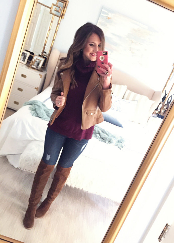 Blogger Mallory Fitzsimmons of Style Your Senses wears a faux leather moto jacket with a turtleneck sweater, skinny jeans and over the knee boots
