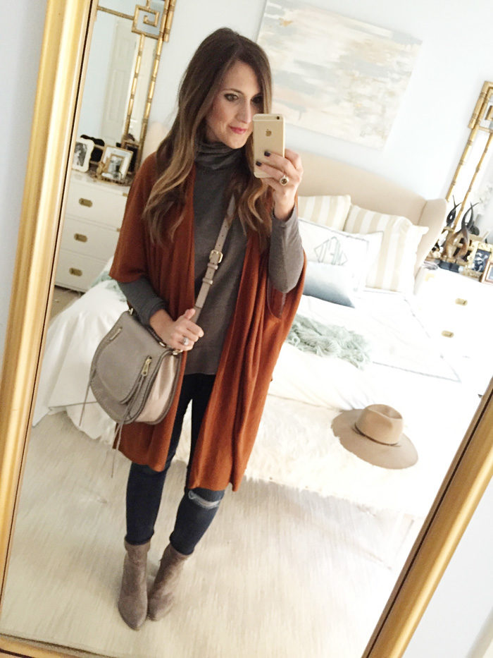 Blogger Mallory Fitzsimmons of Style Your Senses wears a turtleneck tunic with an oversized rust cardigan and dolce vita booties for a festive Thanksgiving look.