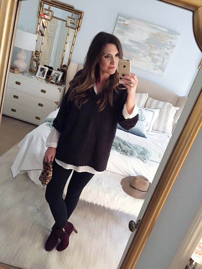 Blogger Mallory Fitzsimmons of Style Your Senses wears a layered tunic and over-sized sweater with tights and Isola booties for a transitional Holiday look