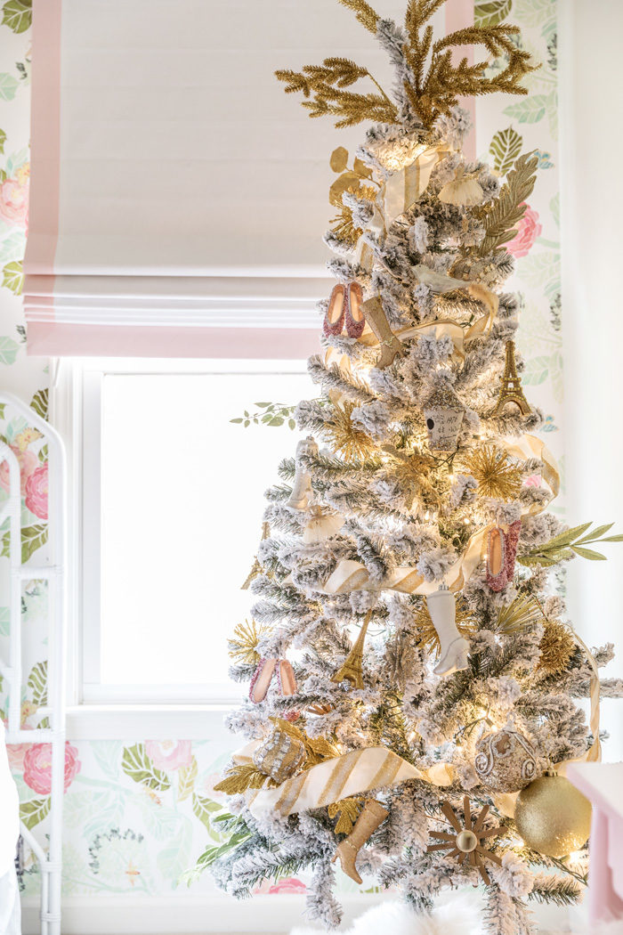 Blogger Mallory Fitzsimmons of Style Your Senses shares her Holiday Home Tour which includes this mini flocked tree in her daughters girly and glam big girl room