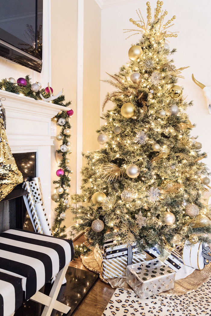 Blogger Mallory Fitzsimmons of Style Your Senses shares her Holiday Home Tour which includes this black and white living room and beautiful gold Christmas tree