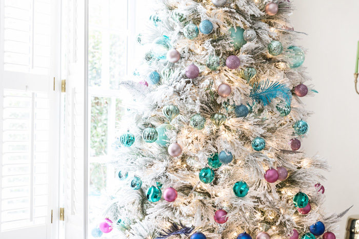 Blogger Mallory Fitzsimmons of Style Your Senses shares her Holiday Home Tour that includes this gorgeous flocked Christmas Tree with blue and pink ornaments