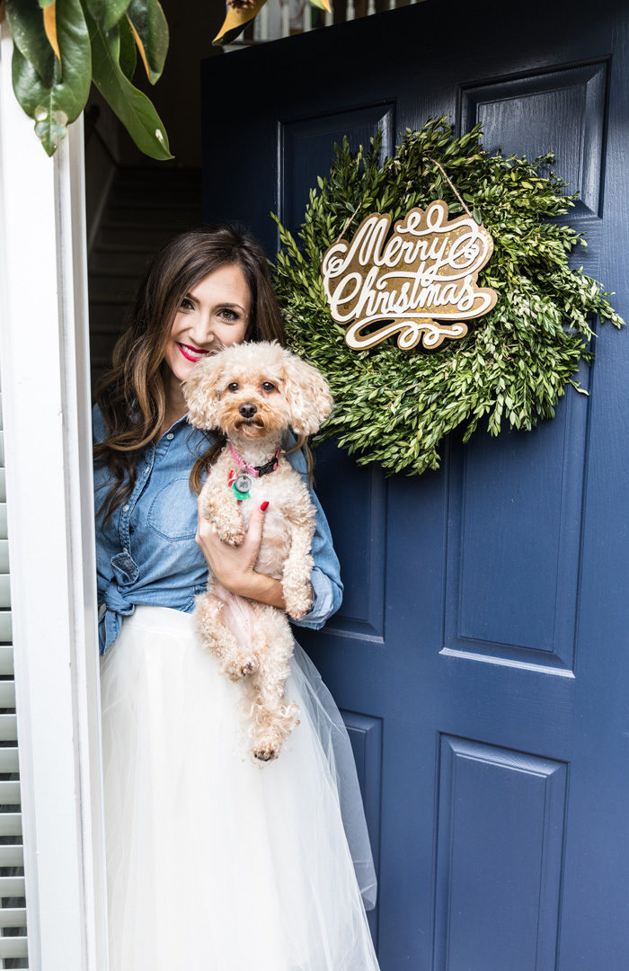 Blogger Mallory Fitzsimmons of Style Your Senses shares her Holiday Home Tour that includes this boxwood front door wreath with wooden Merry Christmas sign