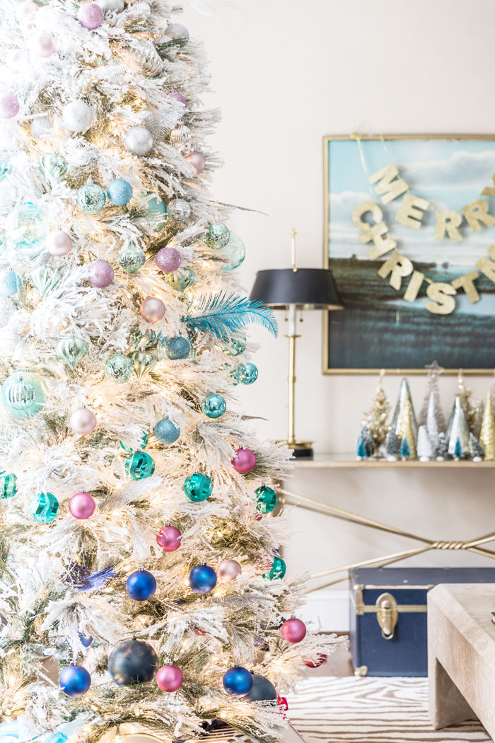 Blogger Mallory Fitzsimmons of Style Your Senses shares her Holiday Home Tour that includes this gorgeous flocked Christmas Tree with blue and pink ornaments - Our Holiday Home Tour featured by popular Texas lifestyle blogger, Style Your Senses