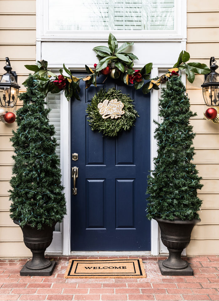 Blogger Mallory Fitzsimmons of Style Your Senses shares her Holiday Home Tour which includes these DIY Christmas Tree planters, gorgeous magnolia garland and boxwood wreath on the front door