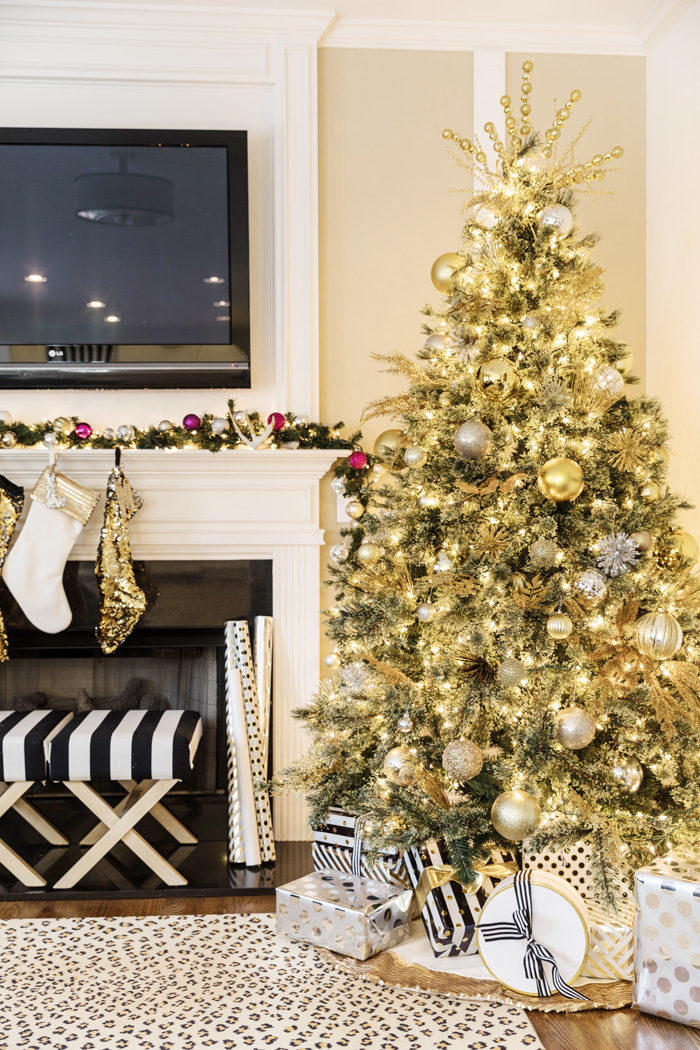 Blogger Mallory Fitzsimmons of Style Your Senses shares her Holiday Home Tour which includes this black and white living room and beautiful gold Christmas tree - Our Holiday Home Tour featured by popular Texas lifestyle blogger, Style Your Senses