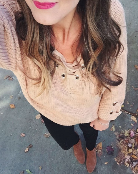 Casual outfit inspiration with lace up sweater and black skinny jeans