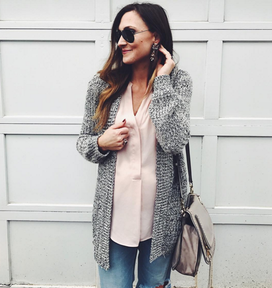Casual outfit layered with a cozy cardigan, sheer tunic an glam earrings