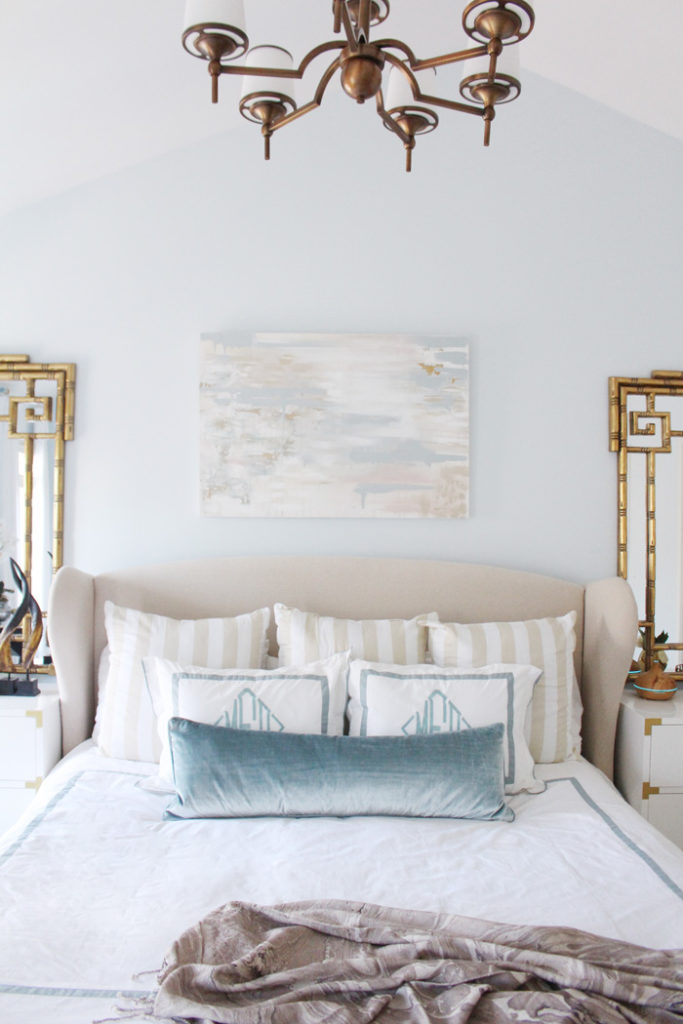 Beautiful, neutral master bedroom with accents of dusty blue and gold