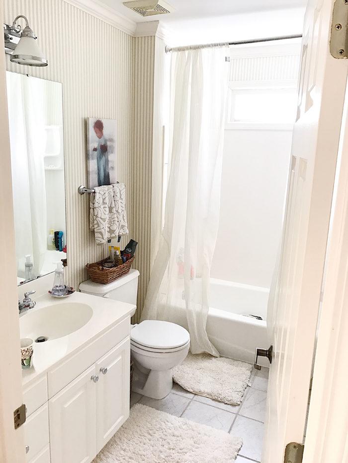 Bathroom makeover BEFORE photo, dated builder bathroom