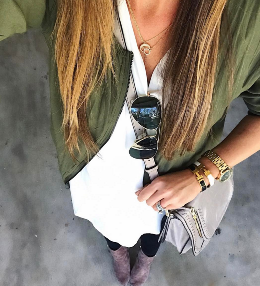 This ivory tunic paired with an army green bomber jacket and black skinny jeans is an easy, and on the go outfit for busy ladies