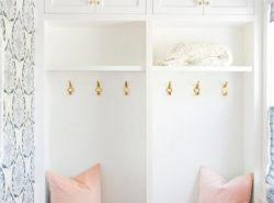 blue-lotus-mudroom-wallpaper-blush-pink-velvet-pillows-vintage-brass-pulls