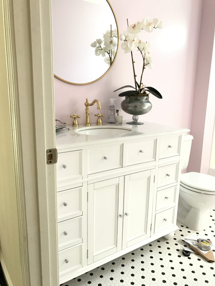 lilac bathroom with gold hardware