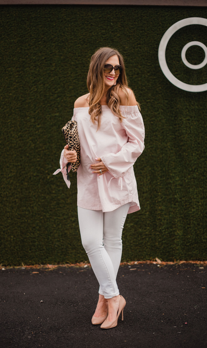 Blush off the shoulder top with white jeans