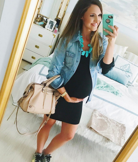 cute maternity outfit idea with black dress and chambray button up
