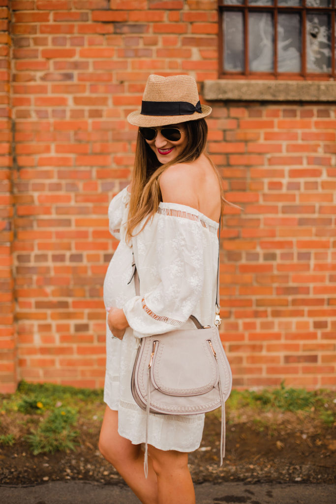 Blogger Mallory Fitzsimmons of Style Your Senses wears a non-maternity off the shoulder eyelet dress to style her 30 week bump for Spring