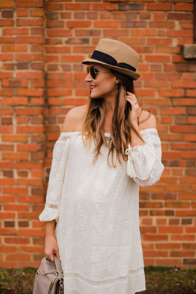 Cream eyelet off the shoulder dress with a fedora hat and gladiatior sandals for Spring