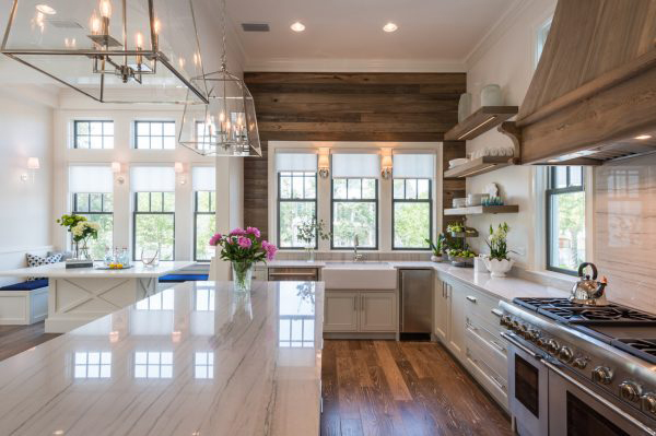 Beautiful kitchen with natural wood shiplap and marble coutnertops