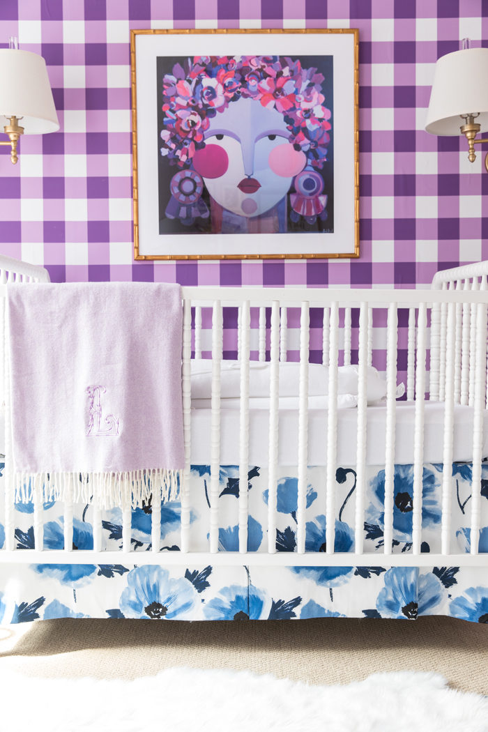 Bright and Bold baby girl nursery design with buffalo check wallpaper, floral fabric and abstract art
