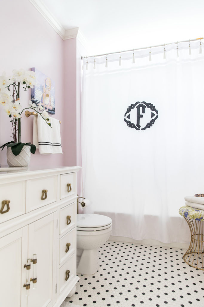 Shared girl's bathroom reveal | Lilac and gold bathroom with black and white tile, original art and applique monogram