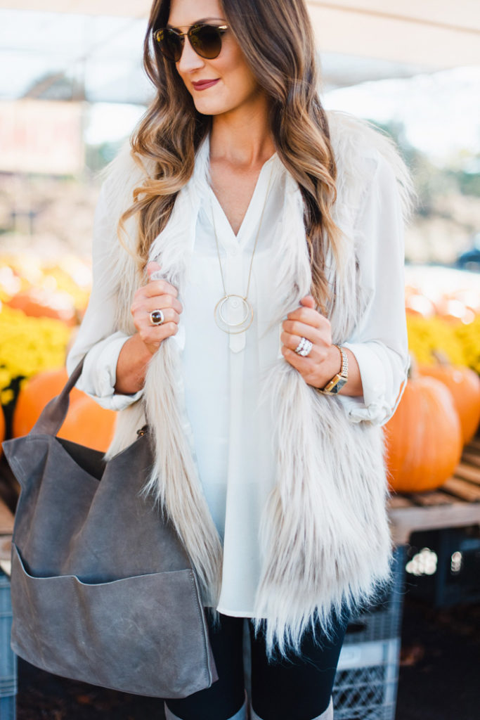 fur vest and over the knee boots 15
