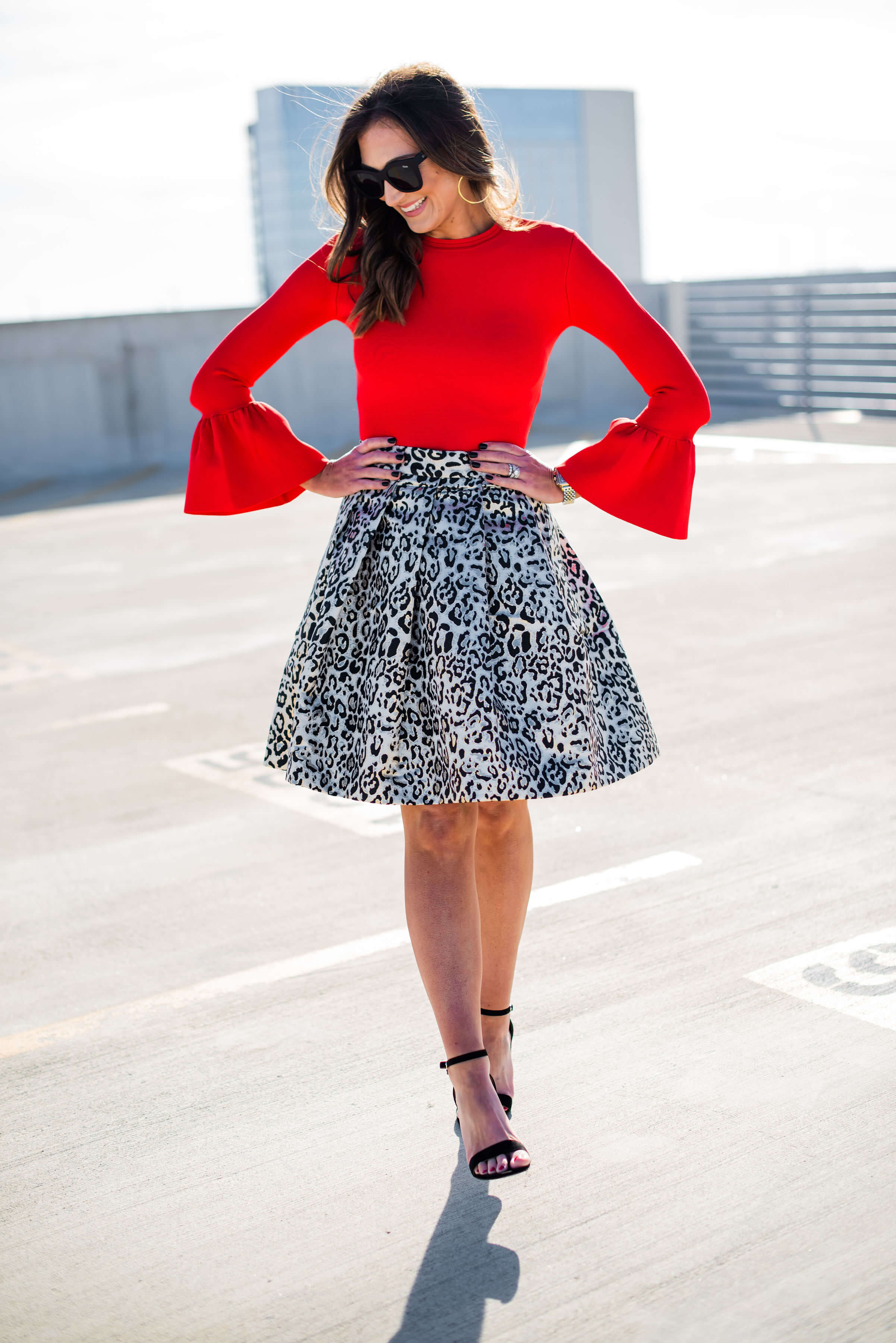holiday party skirt, holiday outfit inspiration, leopard party skirt, red blouse with bell sleeves, style your senses