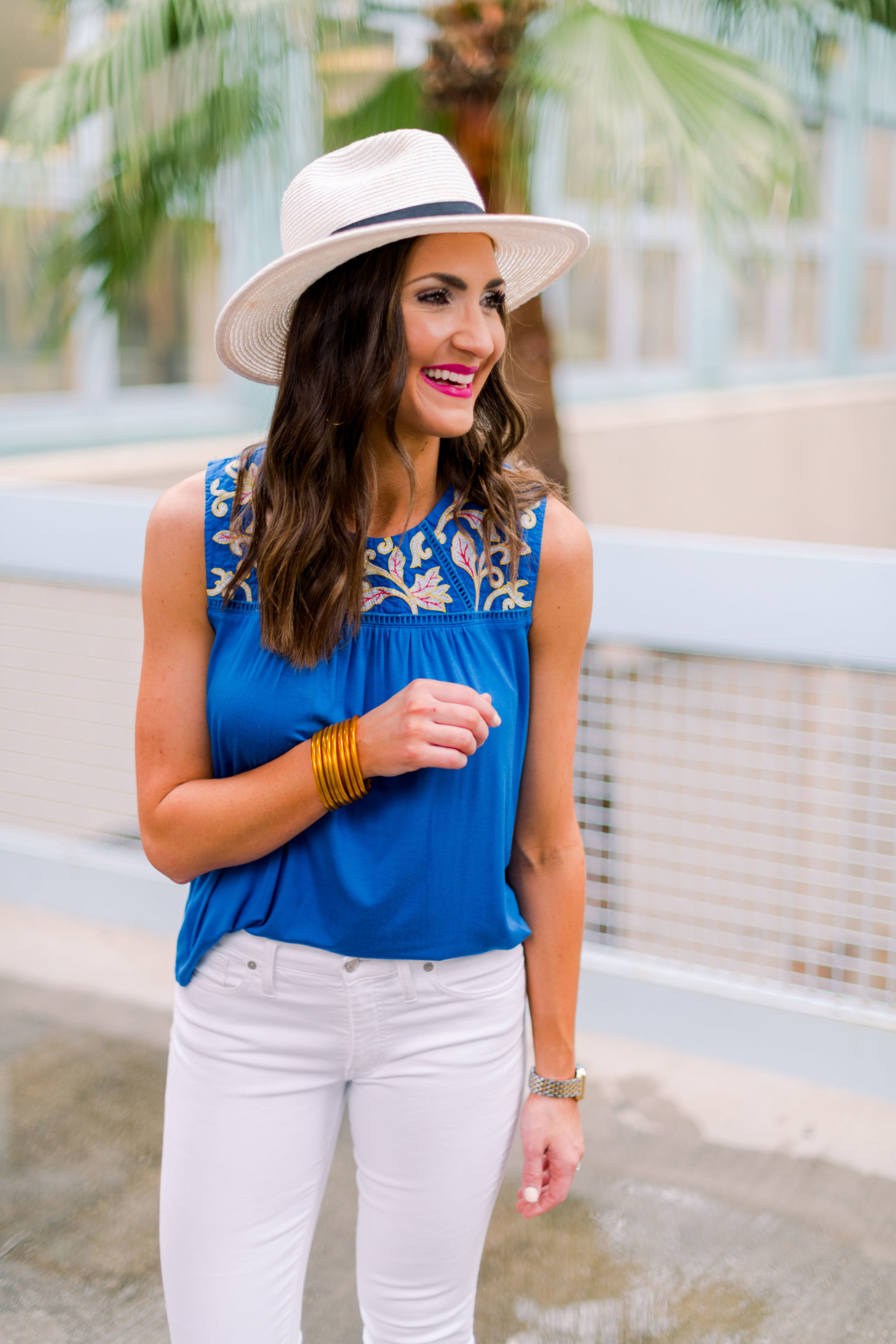 emboridered royal blue top, white skinny jeans, panama hat, resort wear, spring outfit, mallory fitzsimmons, style your senses