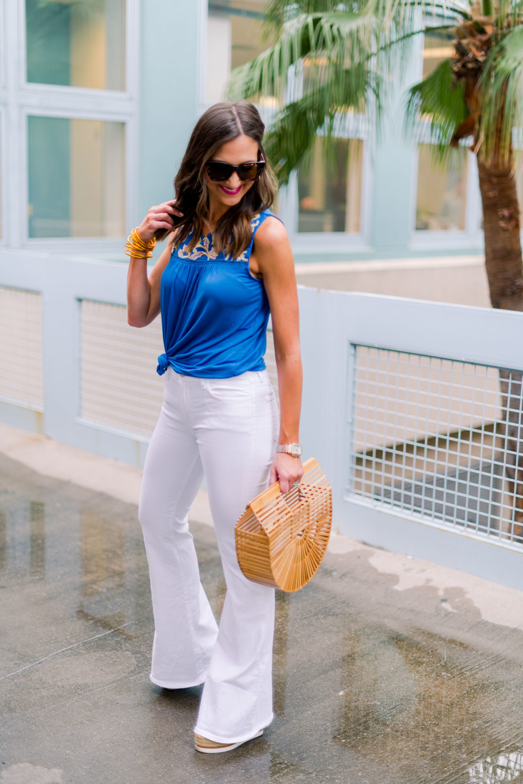 emboridered royal blue top, white flare jeans, panama hat, resort wear, spring outfit, mallory fitzsimmons, style your senses